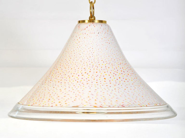 Two Murano glass conical shades speckled in red, orange and yellow over a smooth white ground – contemporary brass fittings. 