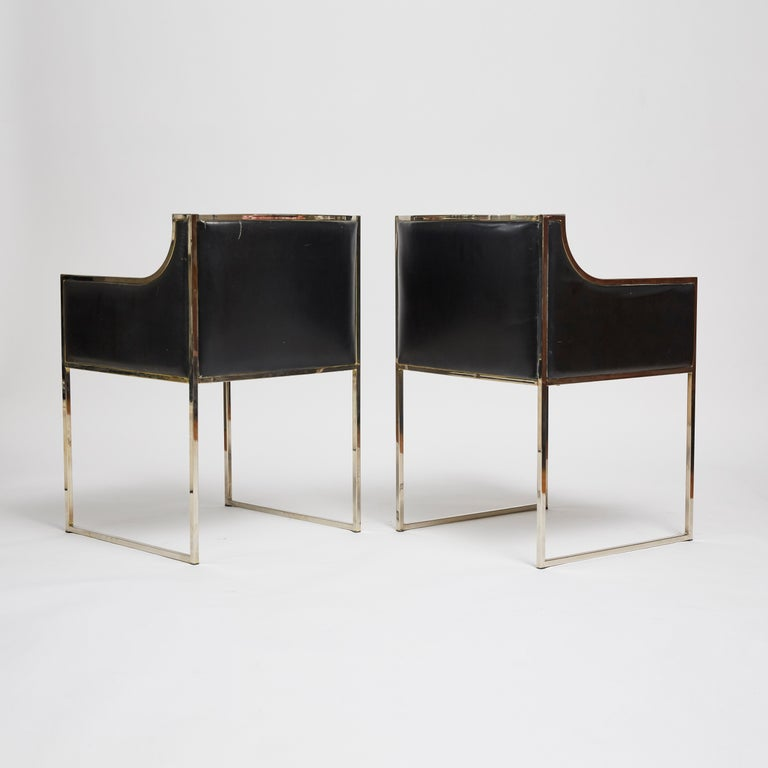 A pair of 1970s Italian armchairs with chrome frame and original black leather upholstery attributed to Willy Rizzo. Chrome frame shows some marks and leather upholstery shows marks and fading consistent with age and use.