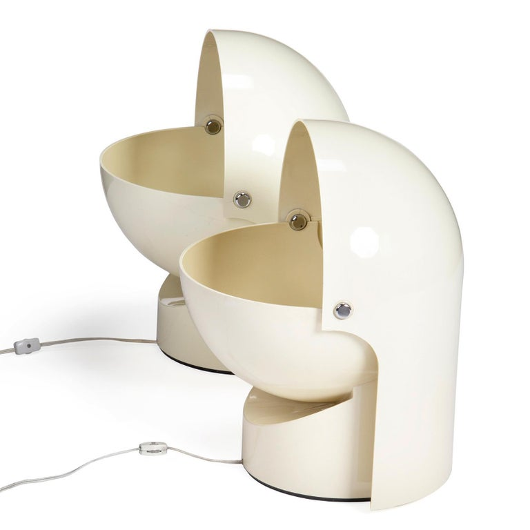 A plastic flush mount wall lamp or floor lamp with rotating shade for Directional lighting.