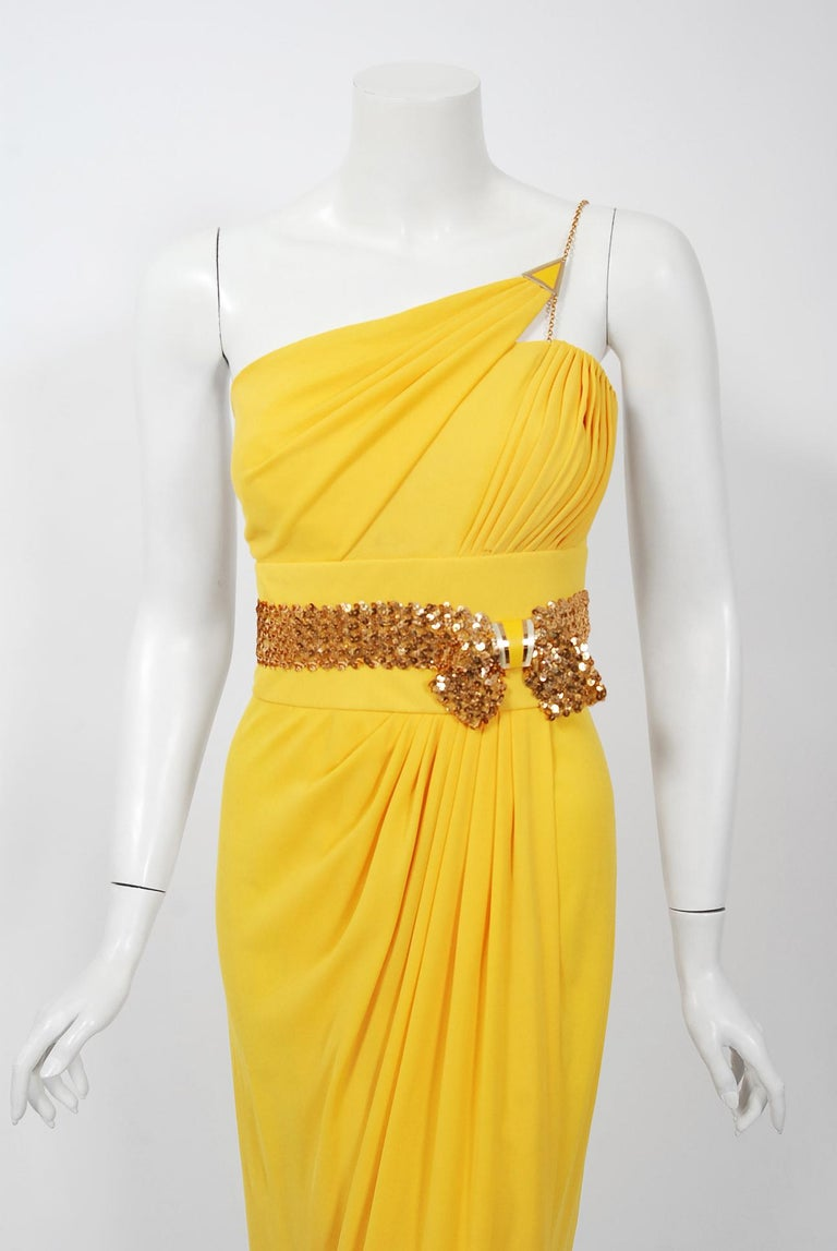 A breathtaking and hard to find Jacques Cassia Couture vibrant yellow dress dating back to the late 1970's.  Though his work has only recently begun to be appreciated, Lebanese designer Jacques Cassia was a familiar face among fashionable