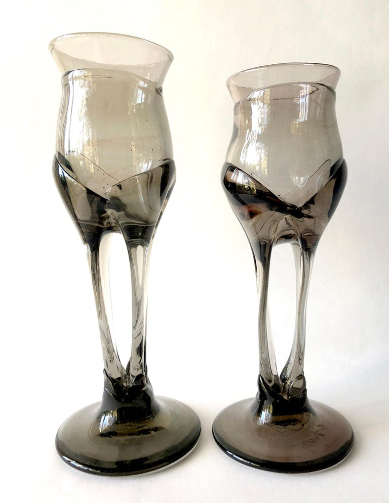 1970s smoked glass organic goblets made by California glass blower, James Wayne. Wayne taught at U.S.C. and San Jose City College and exhibited at the California Design shows in the 1960s and 1970s. Goblets Stand tall 10