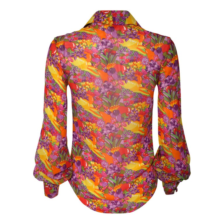 Fabulous late 1960s to early 1970s Jeff Banks colourful floral and fruit salad print shirt made from a very lightweight and floaty viscose type fabric. There are three buttons on each of the straight cuffs with a huge gathered balloon or poets