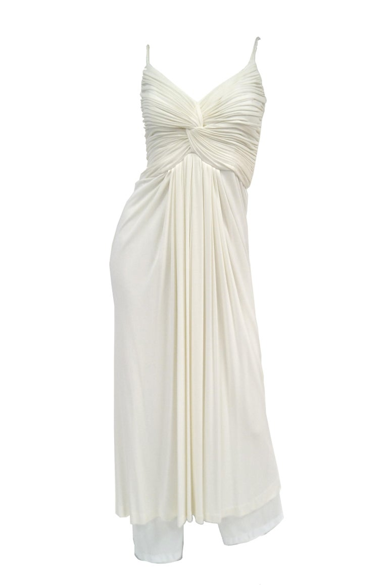 Channel your inner Marilyn or dance like studio 54 could only have imagined in this fun and flirty knit white dress by Jill Richards. The dress ensemble is composed of a white maxi dress and coordinating white knit shawl. The dress has a sweetheart