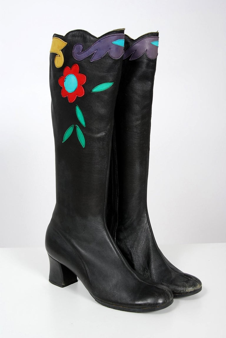 Amazing early 1970's Karina of Spain designer black leather boots with the most incredible floral swirl applique work! These boots have a unique scalloped edging which works so well with the vibe. I love the shaped heel and seductive knee-high