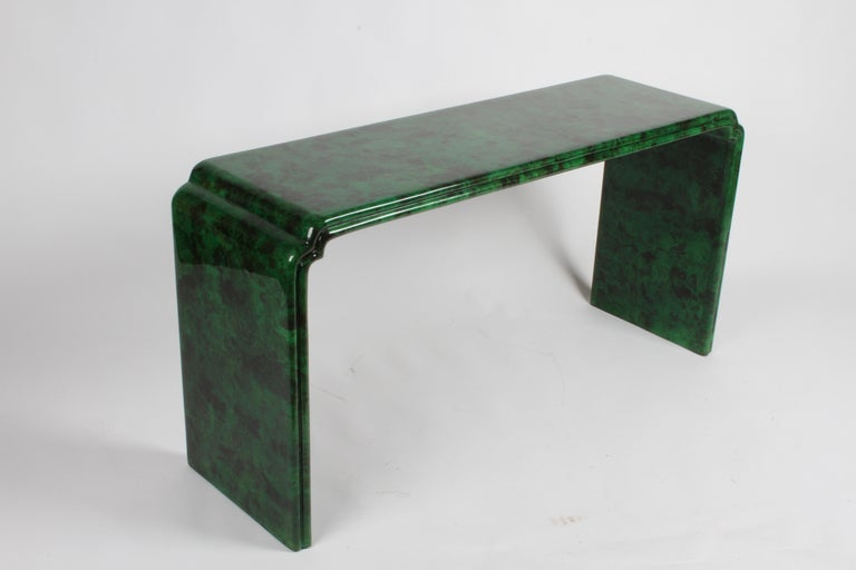 Classic Karl Springer style faux malachite parchment and lacquer waterfall console table from a one owner 1970s designed high style residence. Very Hollywood Regency or Tony Duquette feel to it, with nice edge detail. Overall very nice condition,