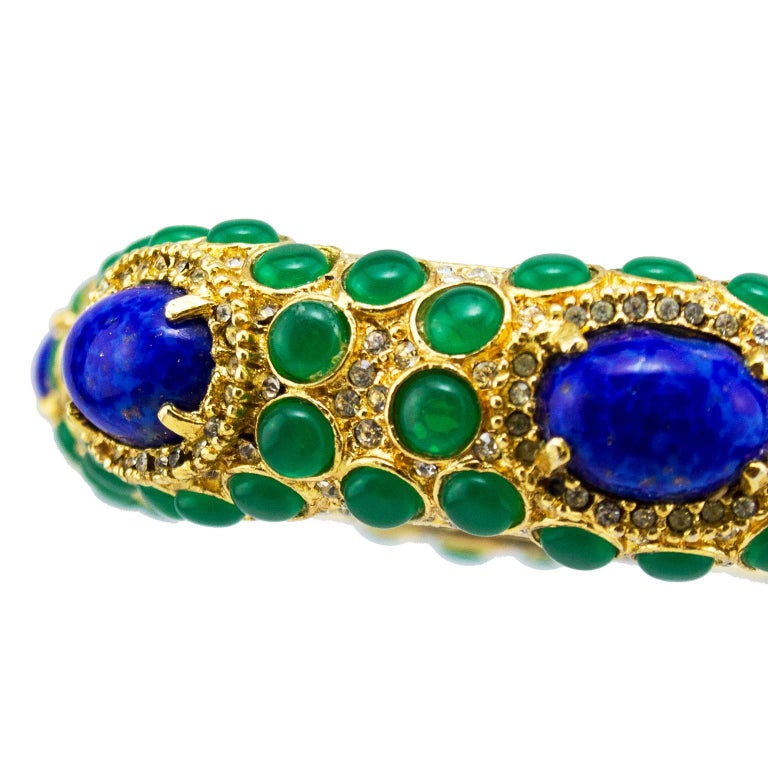 Women's 1970s Kenneth Jay Lane Gold Tone Bangle with Green and Blue Cabochon Stones  For Sale