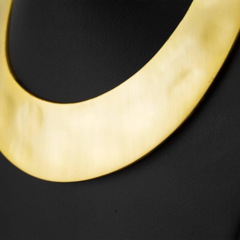 1970s Kenneth Lane brushed gold tone, hammered plate choker. Lays flat at collar bones, with hinges on both sides for easy on and off access. Very good vintage condition, light surface scratching throughout. Kenneth Lane markings on back. Elegant