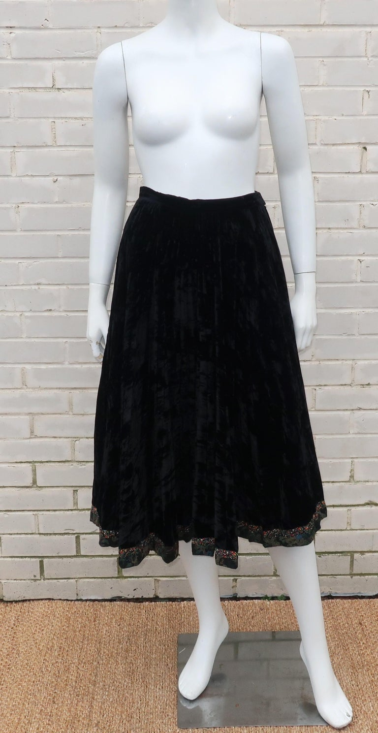 Dutch designer, Koos Van den Akker, became known in the 1970's for his 'collage' clothing designs ... expertly mixing textiles for a great bohemian effect.  This crushed black velvet pleated skirt hooks and zips at the side with a peasant style