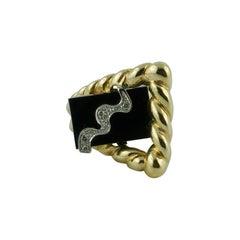 1970s La Triomphe Onyx Gold and Diamond Ring