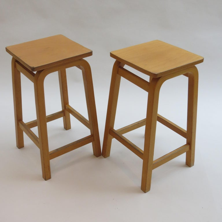 1970s stools originally used in schools, designed by James Leonard for Esavian, UK. Made from Beech plywood with plywood seats. All in really good vintage condition, some wear all-over, the stools retain the original finish.  Base measures 34 x