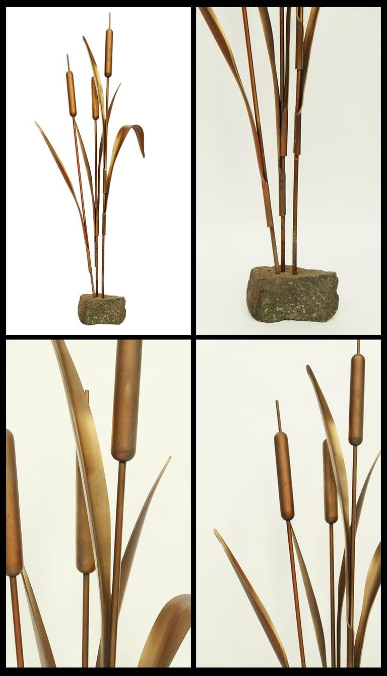 1970s floor-standing bulrush sculpture designed and made in France.  Wood and fiberglass bulrush design with metal stems mounted on a stone base.  Measures: H 162cm x W 65cm x D 24cm.