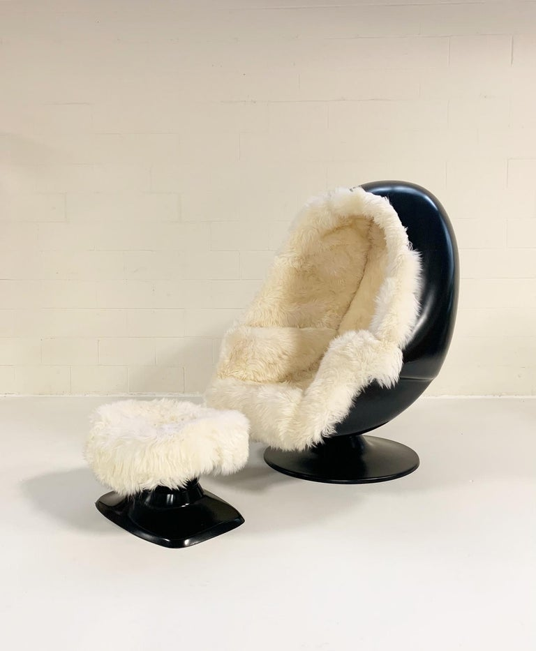 An original 1970s Lee West Alpha Chamber Stereo egg chair in the house! We not only restored the aging upholstery with New Zealand sheepskin, we also painted the fiberglass of the chair and ottoman a beautiful black. We wanted the high contrast of