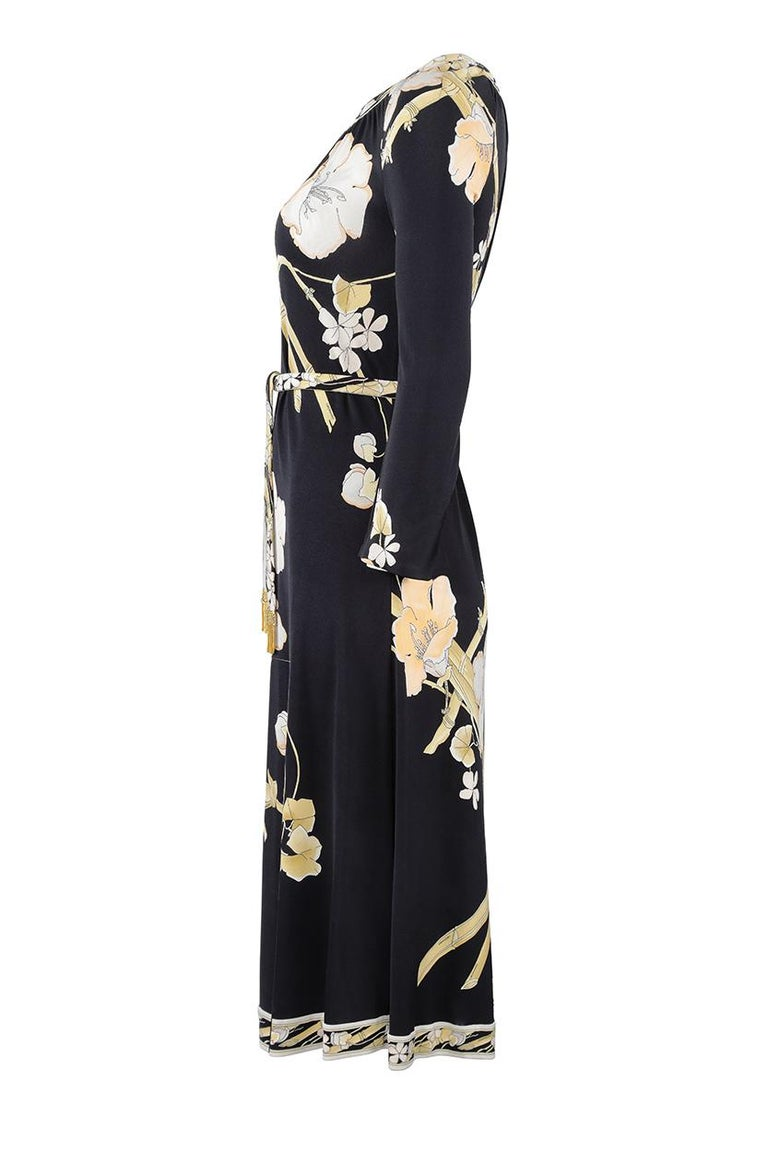 This sophisticated 1970s pure printed silk jersey dress is by French fashion house Leonard studios and is in impeccable vintage condition. The designer Daniel Tribouillard defined his aesthetic using printed silk fabrics, much akin to Pucci with