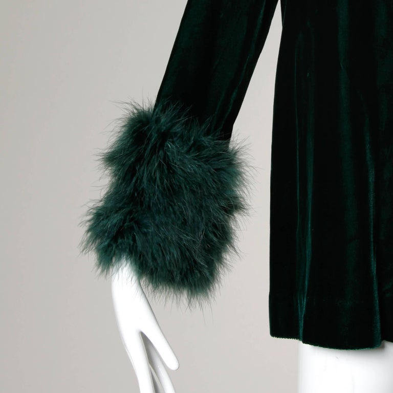 Vintage 1970s dark green velvet swing jacket with marabou feather cuffs. Fully lined with front snap closure. The marked size is 12, but the jacket fits more like a modern size small-medium. The measurements are as follows: Bust: 40