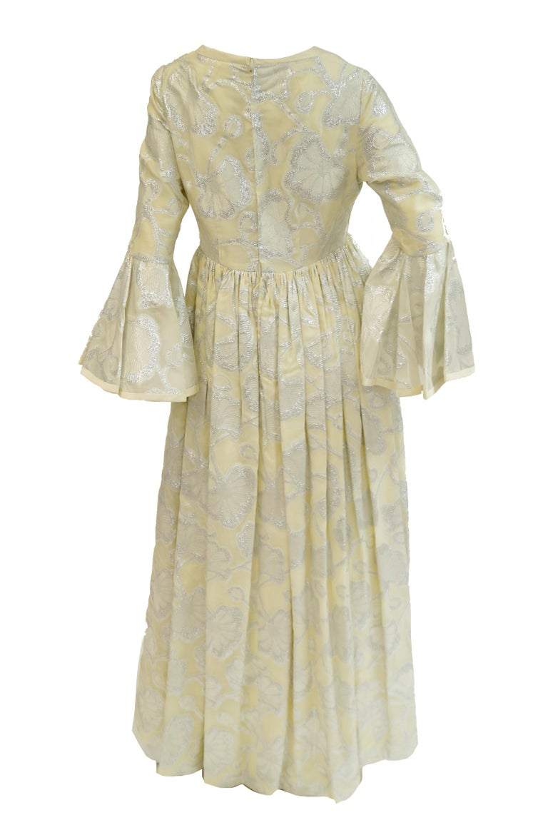 1970s Lisa Meril Cream and Silver Floral Brocade Empire Waist Evening Dress For Sale 1