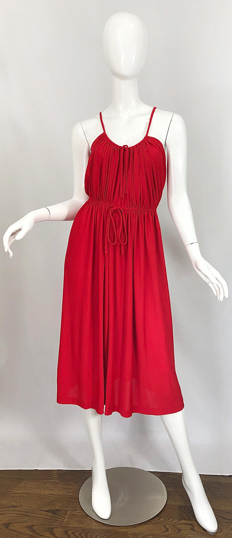 Chic 1970s LORIS AZZARO crimson red silk jersey Grecian Inspired spaghetti strap dress! Features flattering and forgiving draped bodice with ties at the bodice and waist to adjust for size. Avant Garde triangular back. Hidden metal zipper up the