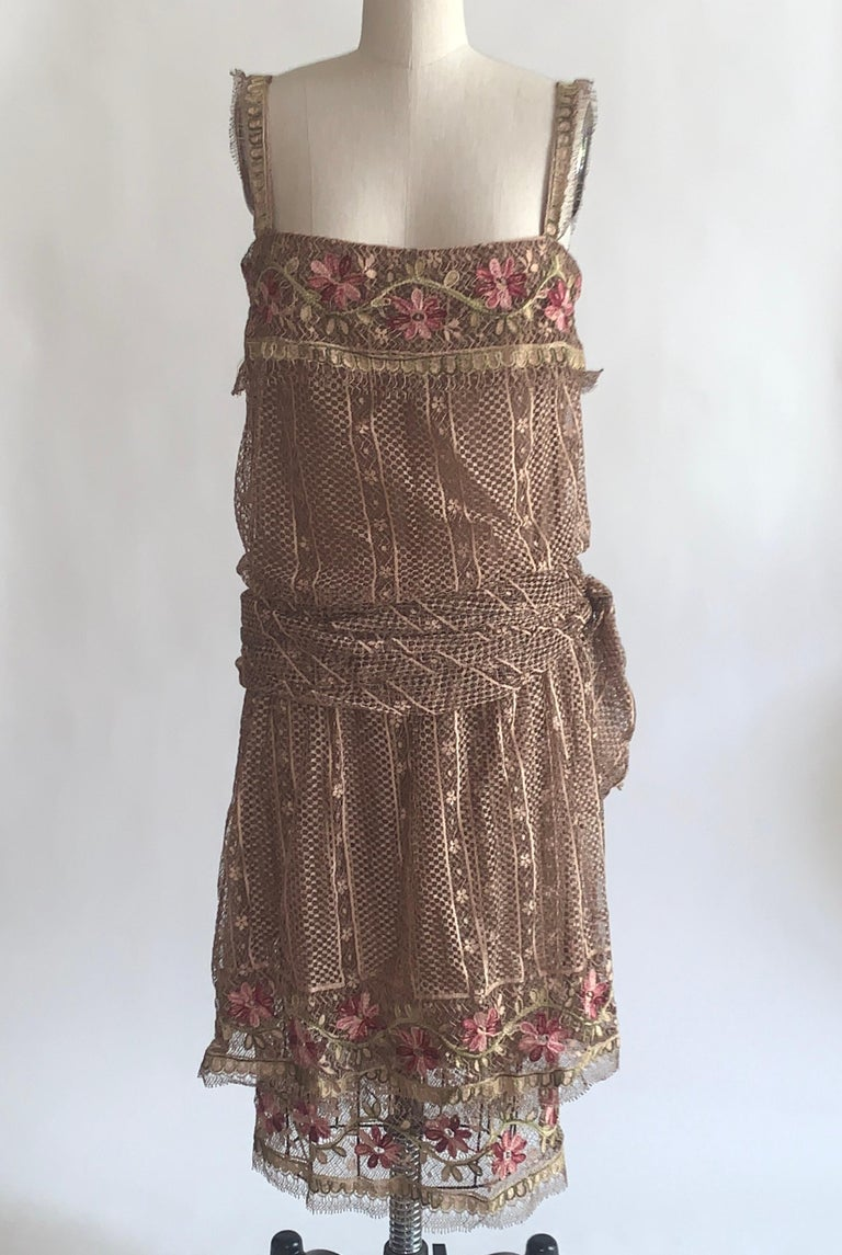 Louis Feraud 1970s haute couture light brown lace dress in a 1920s style drop waist silhouette. Amazing embroidered lace and hand finished seam allowances. Small buttons conceal a back zip.  Lace exterior, fully lined in what feels like silk.  Made