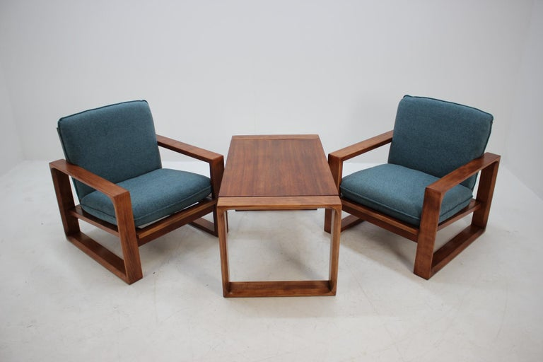 Made in Czechoslovakia. Set of two chairs and coffee table. Newly upholstered. Carefully refurbished. Dimensions of the coffee table height 50cm, width 90cm, depth 55cm.