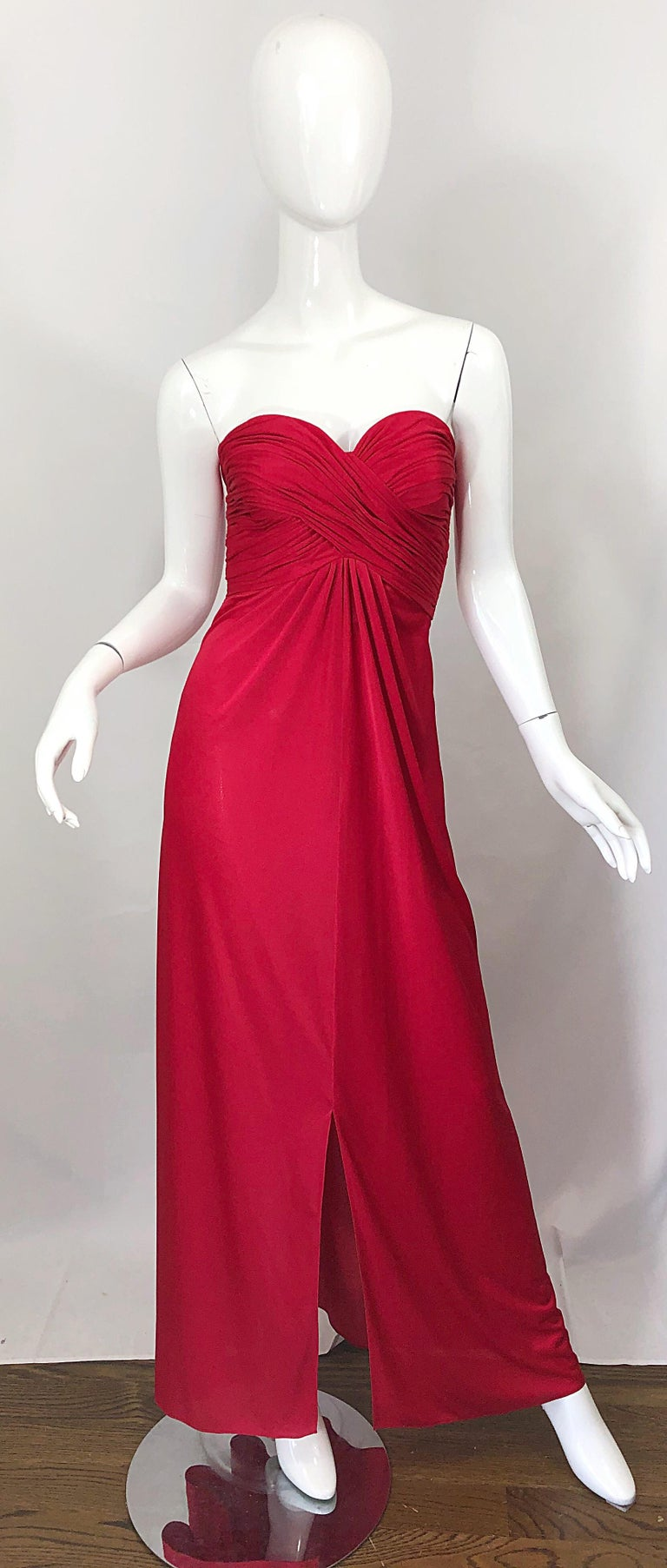 Beautiful mid 1970s LUIS ESTEVEZ lipstick red silk jersey strapless Grecian gown / maxi dress ! Features an intricate gathered boned bodice. Full metal zipper up the side with hook-and-eye closure. Slit up the center hem. Couture quality, with so