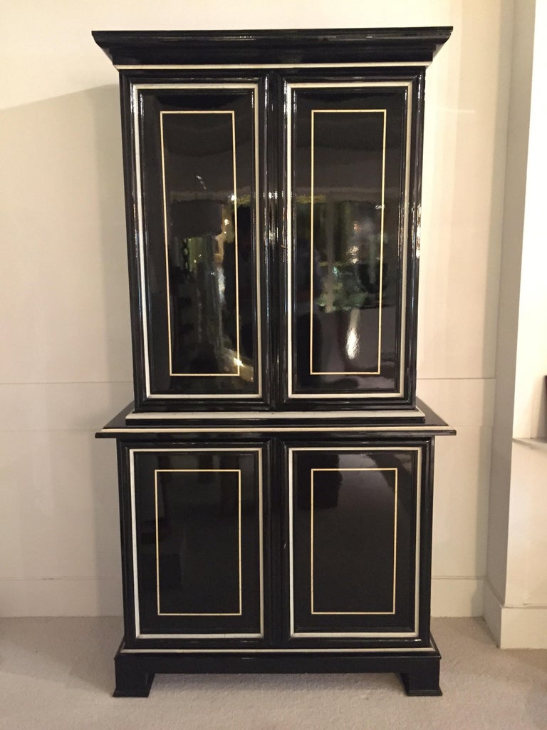 Black and faux ivory lacquered Trumeau by Maison Jansen. Mirrored Interior on the top doors. Can be found on Maison Jansen Book by Archers Abbot. Great condition for the lacquer.