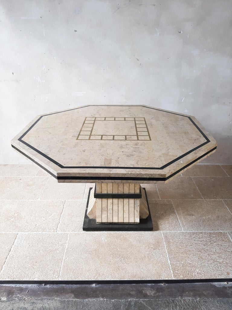Maitland Smith tessalated marble dining table. Midcentury, vintage dining table from the 70s by maitland Smith. This Miami Vice style hectagonal diningtable is made from tesselated marble and in the top and in the base laid in with brass. The