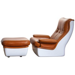 1970s, Marc Held Airborne Lounge / Easy Chair and Ottoman in Cognac Leather