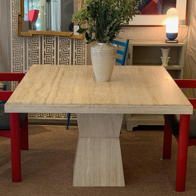 Really great square travertine pedestal table that is versatile for smaller dining or center table. Sold through modern furniture retailer Maurice Villencey in the 1970s.
