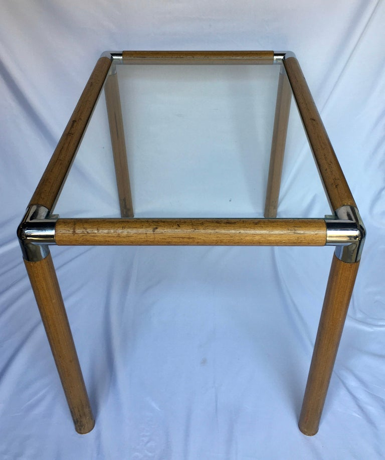 Mid-Century Modern side table featuring a tubular wood frame with chrome corner caps. This rectangular end table has a removable clear glass top.