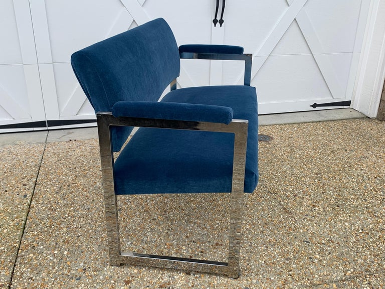 Offered is a stunning, 1970s chrome Milo Baughman settee. The piece has been professionally reupholstered in a gorgeous, blue velvet by Thibaut. The cobalt blue appears much brighter in the photos, than it actually appears in person. Please see last
