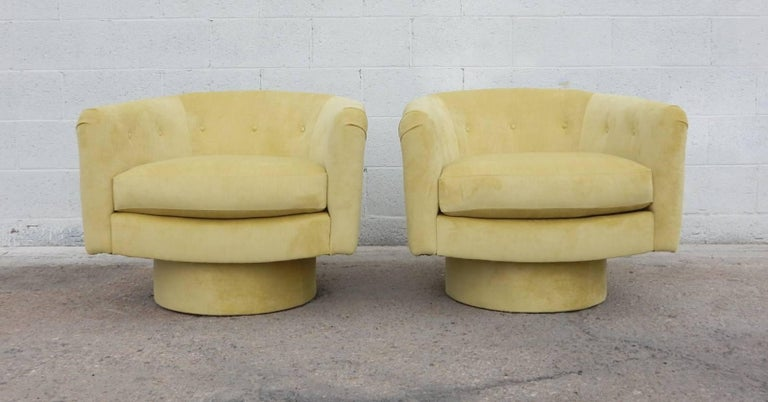A pair of petite swivel lounge chairs designed in the style of Milo Baughman. We just had them professionally reupholstered in a canary yellow velvet. Like new condition ready to be enjoyed on delivery.