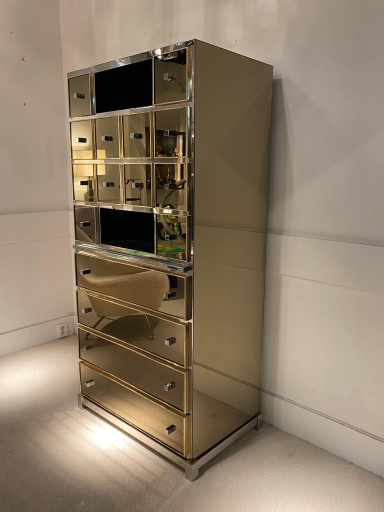 1970s mirrored cabinet by Michel Pigneres. Brass. Bronze mirror and chrome handles. Sliding table in the cabinet Great condition.