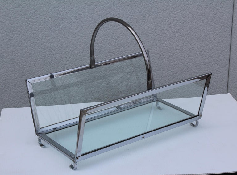 1970s modern chrome and glass log holder with scrolled feet, well made and very heavy.   Measures: Height including handle 16
