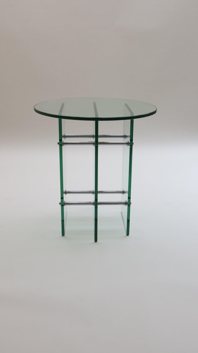 An exceptional quality glass side table. Made from thick tinted glass base and separate glass tabletop. The base is held with good quality nickel plated steel rods. The table is probably Swiss origin and dates from the 1970s.