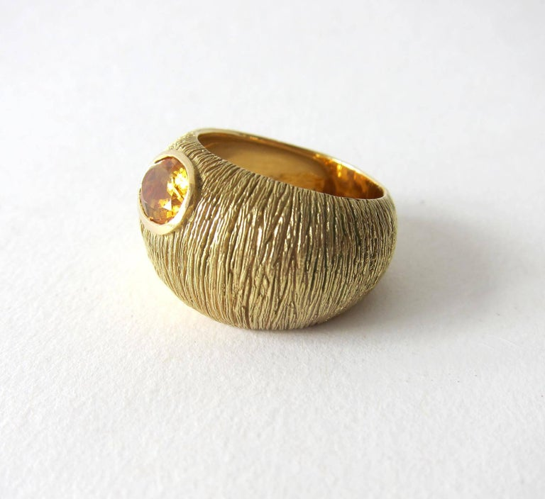 Textured 18k gold with faceted oval citrine stone ring circa 1970's.  Ring is a finger size 9 - 9.25 due to its unusual shape.  Signed 18k on inside shank and in very good vintage condition.  14.8 grams