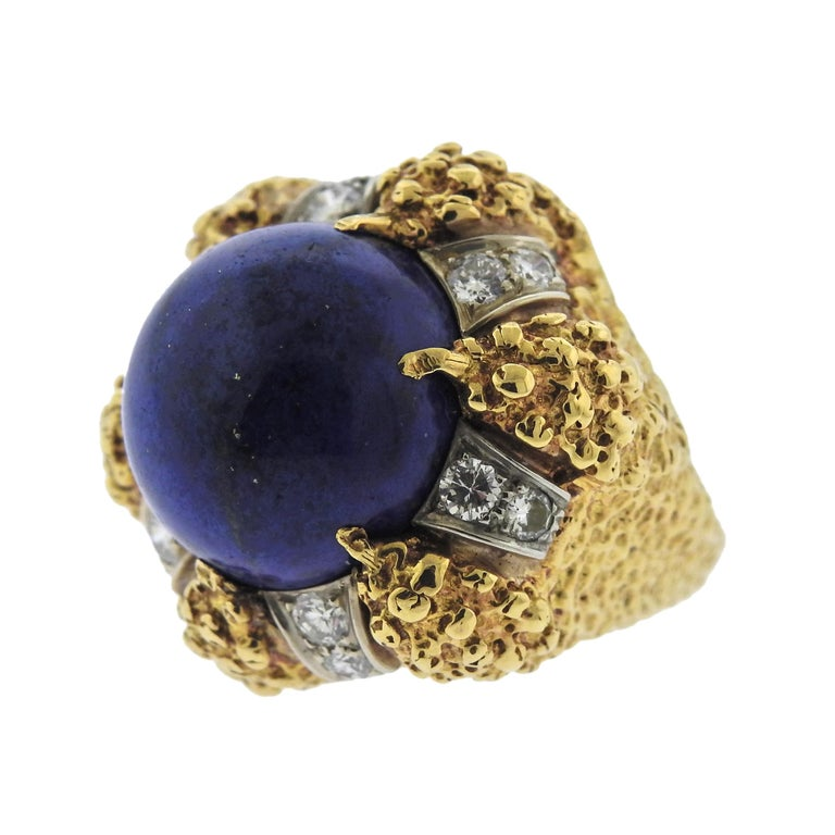 18k gold modernist vintage ring, crafted in circa 1970s, set with 16mm lapis, surrounded with approx. 0.90ctw in VS-SI1/H diamonds. Ring size - 6.25, ring top - 25mm x 25mm, weighs 22 grams. Marked: 18k.