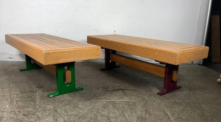 1970s modernist wood and cast iron architectural garden, gallery benches, heavy slat oakwood construction, cast iron bases, Industrial yet elegant design.