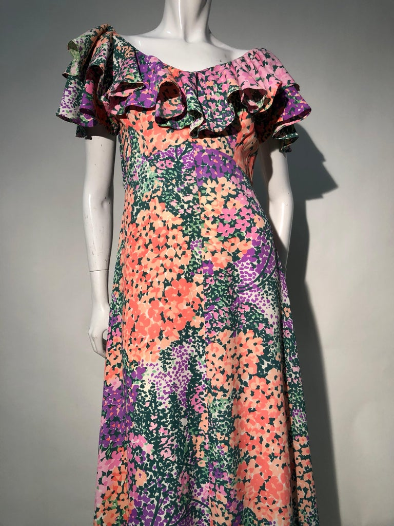 A very pretty 1970s-does-1930s bias cut maxi dress with heavily ruffled neckline. The Monet-inspired floral print is a joy to wear. Center back zipper. Sweeping hemline.