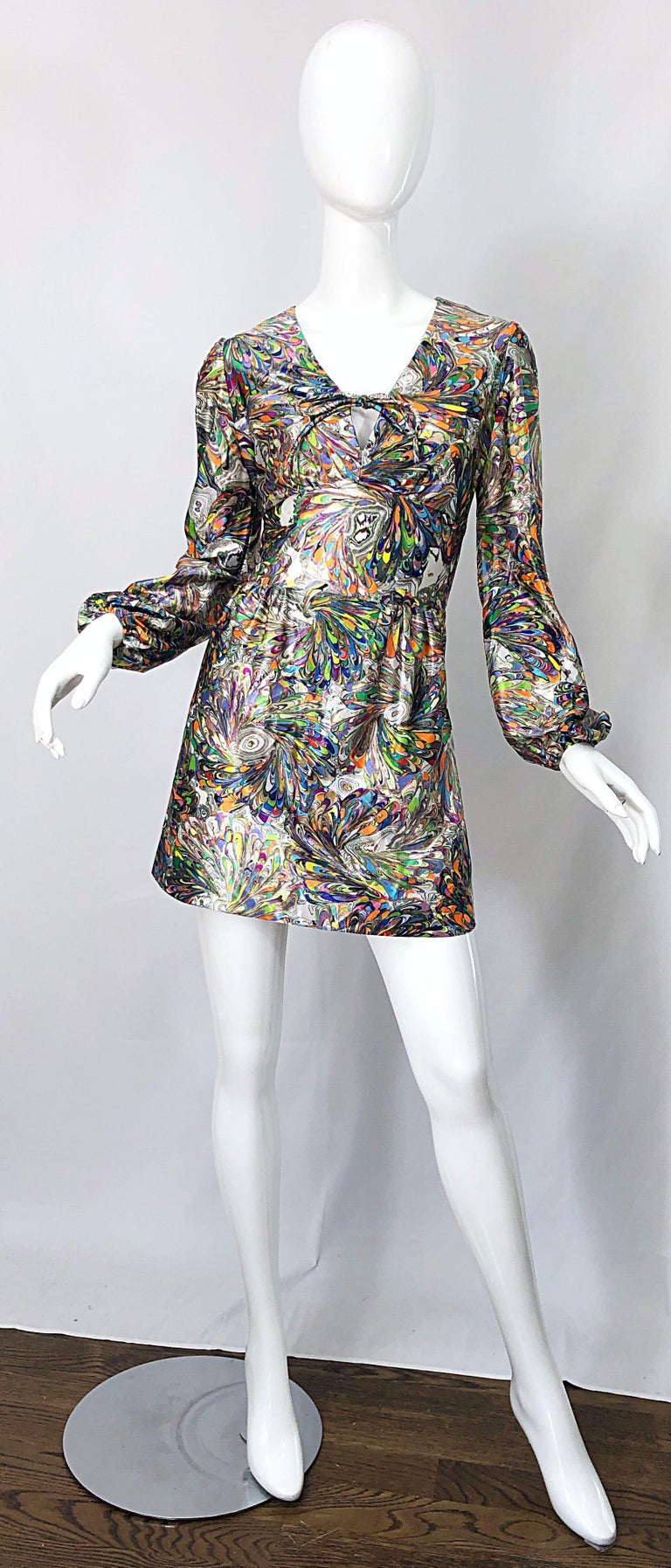 Amazing early 70 vibrant color mosaic swirl print bishop sleeve mini dress or tunic top ! Features a bright rainbow colors of purple, blue, neon green, orange, yellow, hot pink, and white throughout. Ties at center bust. Hidden zipper up the back