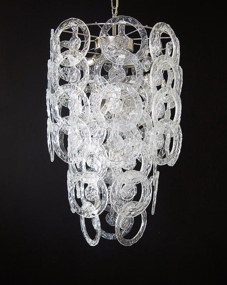 1970s Murano Vistosi glass chandelier - 65 transparent hooks of circular shape Period: 1970s. Dimensions: 57.10 inches (145 cm) height with chain; 29.50 inches (75 cm) height without chain; 16.50 inches (42 cm) of diameter. Dimension glasses: