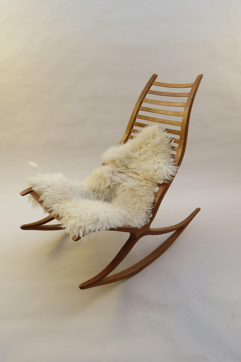 """A stylish and sculptural hand produced rocking chair from the 1970s, designed and produced by Robin Williams, UK.  Made from laminated oak with a removable padded leather seat. Retains the original """"Selected for Design Centre London"""""""