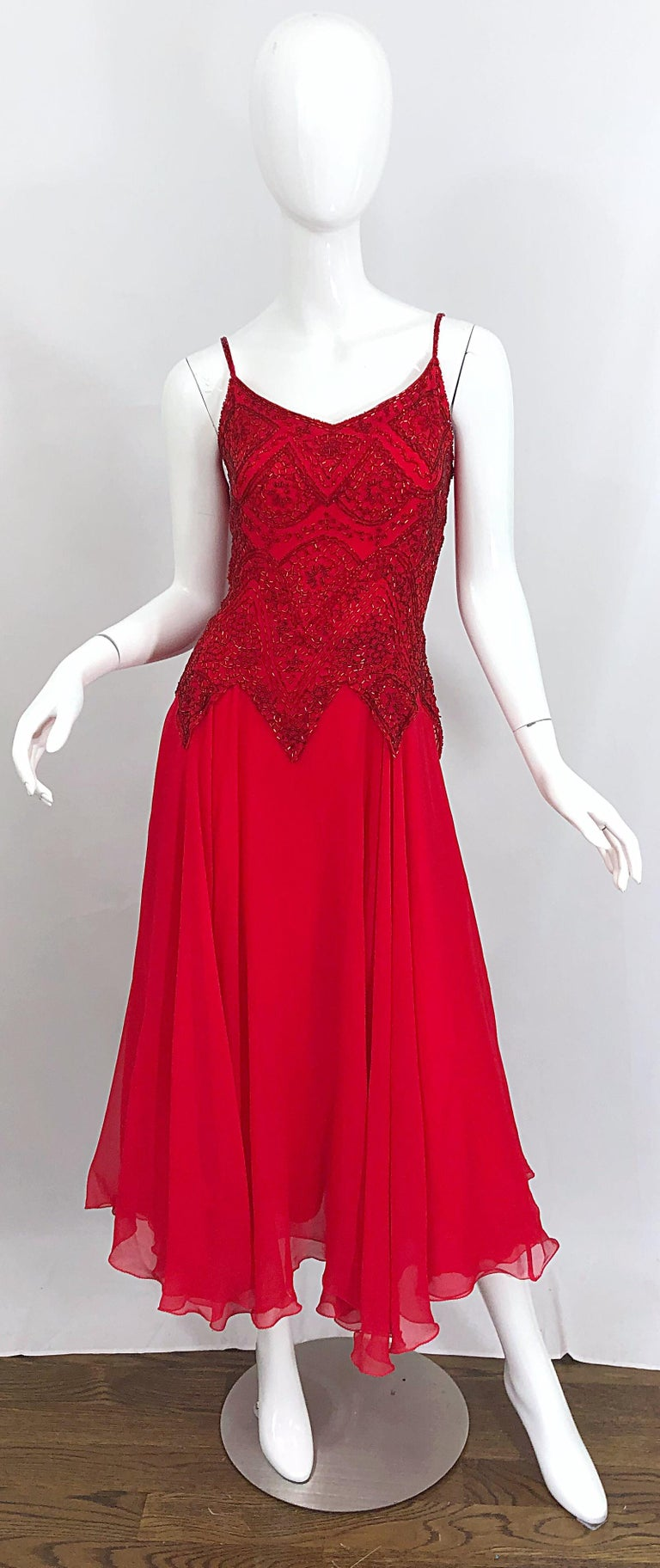 Beautiful vintage 70s OLEG CASSINI lipstick red silk chiffon beaded handkerchief hem Size 10 / 12 midi dress / gown ! Features hundreds of hand-sewn red beads on the bodice. Asymmetrical hem that slightly dips on the back hem. Multiple layers of