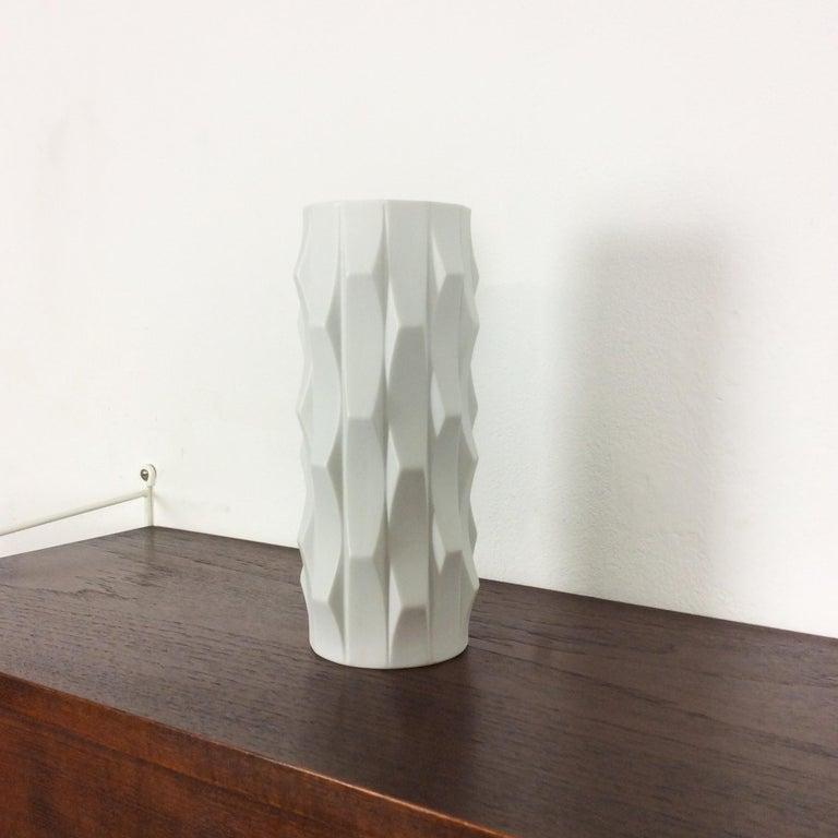 Article:  OP Art porcelain vase   Producer:  Hutschenreuther, Germany   Designer:  Heinrich Fuchs    Decade:  1970s    Description:  This original vintage OP Art vase was produced and designed by Heinrich Fuchs in the 1970s