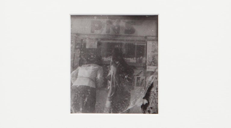 Original Miroslav Tichý b/w Photography from 1970. Unique vintage gelatin silver print. Including black wooden frame in H 27 / W 25.5 cm. This original Miroslav Tichý motif depicts two women photographed from behind while shopping.   Miroslav Tichý
