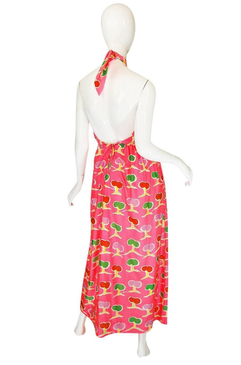 I have had a similar dress to this one in a darker color combination and slightly different neckline but I think that I love the vibrant pink of this one a bit more. It is a stunning design and an early example of De La Renta's work. The colors on