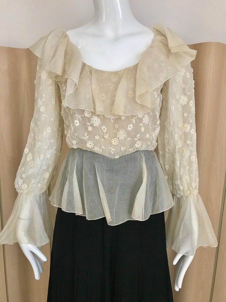 Vintage 70s Oscar De La renta Creme silk ruffle jumpsuit with black silk pleats pants. Size: 4 Bust 34 inches/ Waist 27 inches/ Hip; 38 / Jumpsuit length 53 inches