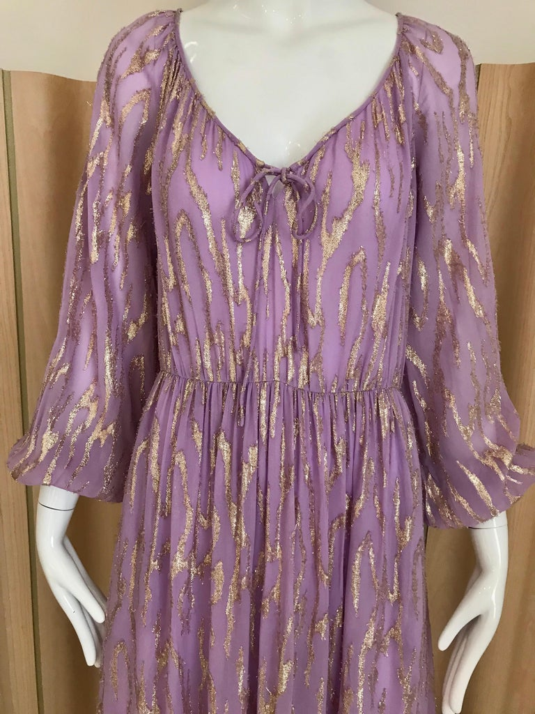Vintage 70s Oscar de la rent a purple lavender long sleeve dress with gold metallic sheen. Bust: 40 inches/ waist 28 inches/ Dress length: 56 inches/ sleeve length: 25 inches **belt sold separately