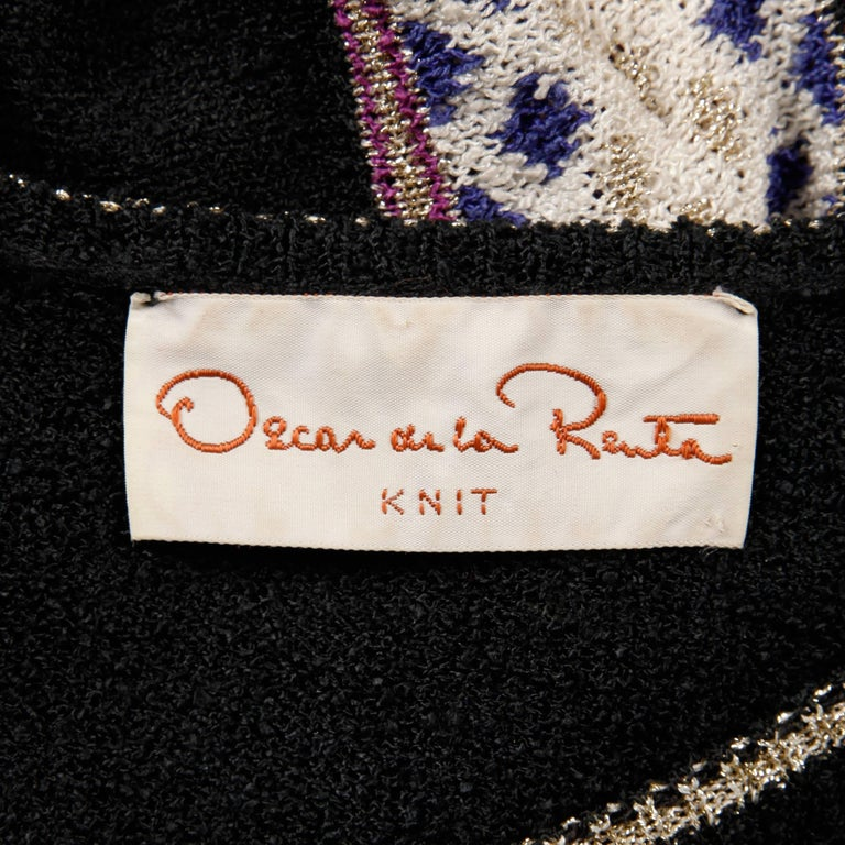 Amazing vintage 1970s knit sweater top, skirt and knit tie belt by Oscar de la Renta. The top is unlined with no closure (pulls on over the head). The bust measures 33-36