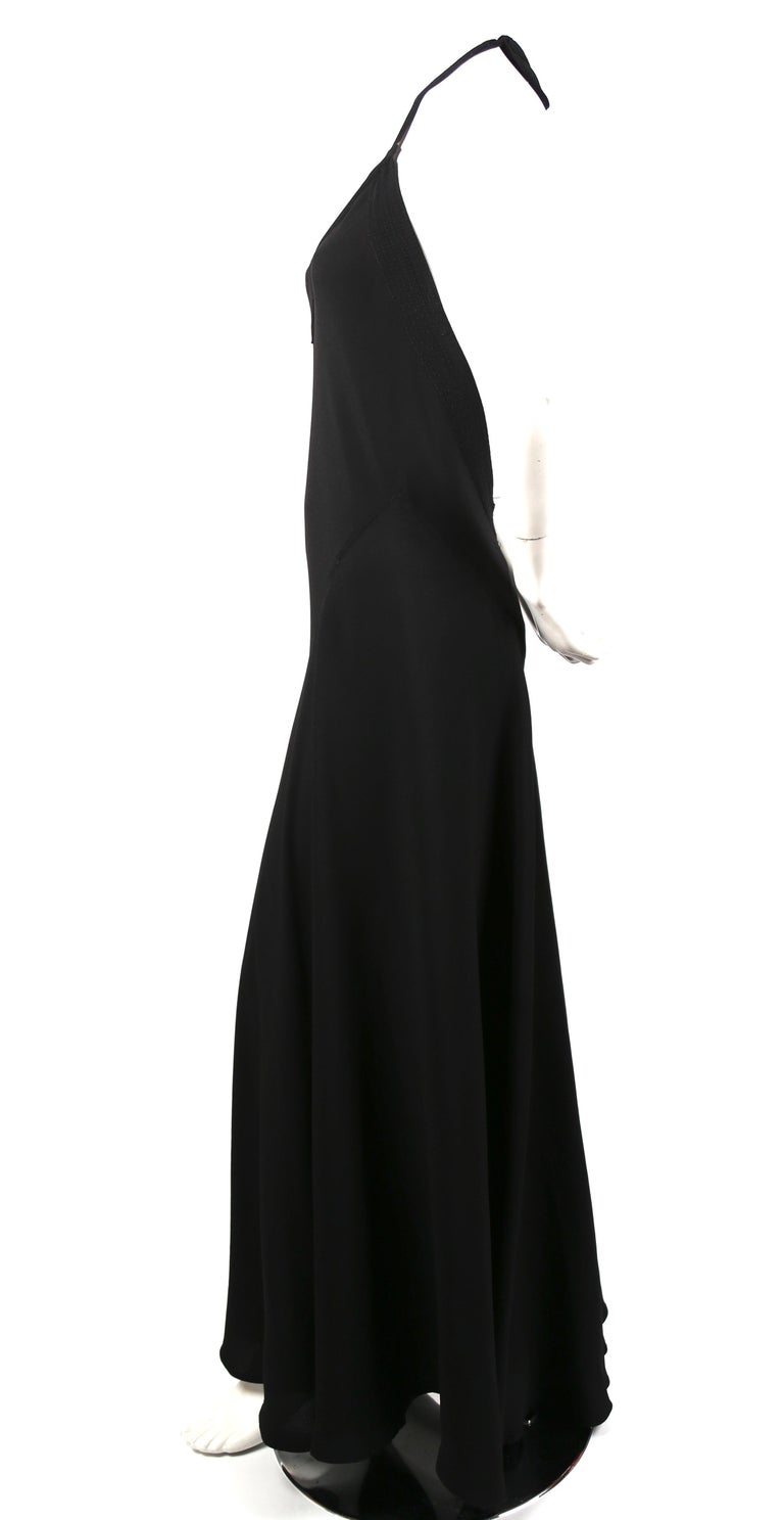Jet-black, moss crepe, bias-cut maxi gown with deep-V front and back from Ossie Clark for Quorum. Beautiful, decorative top-stitching detail around bodice. Dress is labeled a UK 14 however this dress best fits a modern US 4-8. The dress was not