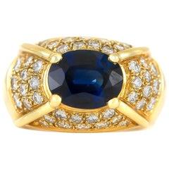 1970s Oval Sapphire with Diamonds on 14 Karat Yellow Gold Setting