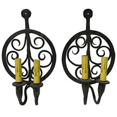 1970s Pair of Colonial Double Arm Wrought Iron Candlestick Sconces